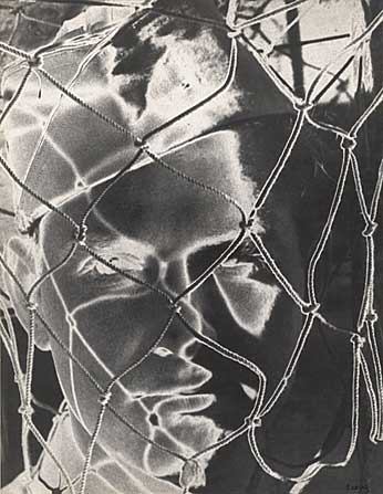 Face Net, Vintage solarized silver print, 1945.